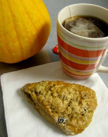 A photo of tea and pumpkin scone